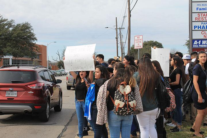 Students++walked+out+of+school+at+noon+to+protest+Trump%27s+immigration+laws+and+the+racism+many+of+them+encounter+on+campus+every+day.+They+held+up+posters%2C+chanted+and+made+their+way+down+Park+Row%2C+cheering+when+drivers+honked+in+solidarity.