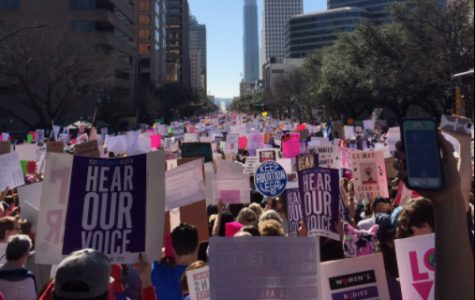 Women's rights supporters flood city streets in solidarity, Colts join the throng