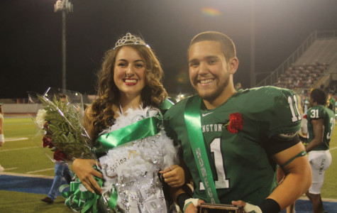 Seniors Bailey Harris and Colton Fulton smile after being crowned Homecoming queen and king.