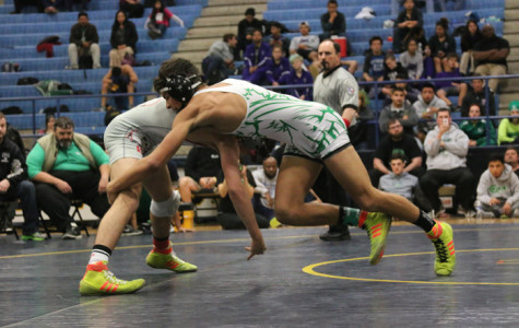 Senior Quentin Perez gets ready to take down his opponent. Perez was ranked as one of the top wrestlers in the state by the end of the season.