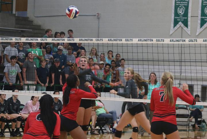Senior Brooke Fearka hits the ball over the net and over the heads of the Cedar Hill Longhorns.