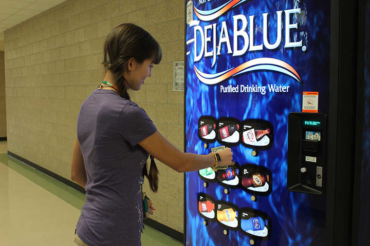 Looking for a caffeine kick, junior Isabella Rodriguez stops by the new soda vending machine. The machines were brought back to campus to curb students leaving school to get snacks.
