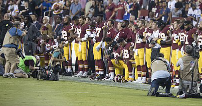 Members of the Washington Redskins kneel during the national anthem before facing the Oakland Raiders on September 24. To protest inequality in America, many NFL players took a knee during the playing of the national anthem at their end of September games. The protest on a national platform brought both praise and criticism.