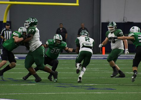 Senior RB Kenland McCray makes a break for it past a Southlake Carroll Dragon. The Colts lost 28-24 in the third round of playoffs.