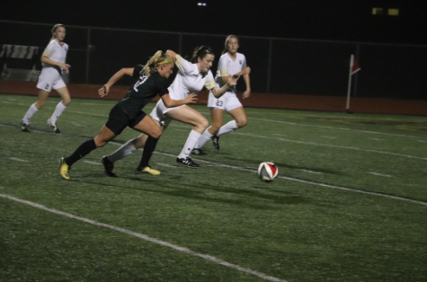 Junior Kayley Dahlin aggressively rushes to win control of the ball. The Lady Colts finished the year with a 13-1 record in district play but fell to Keller High School in the first round of playoffs.