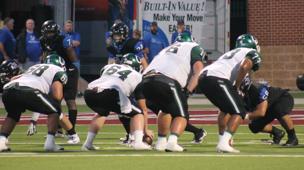 The offensive line lines up against Byron Nelson. The Colts beat the Bobcats 37-34.