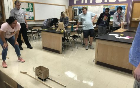"Students in Mike Roark's AP Physics C class participate in a projectile design lab. ""About 50% are female in my first year Physics class; however, about ⅔ of my second year class are males,"" Roark said. With the hashtag"